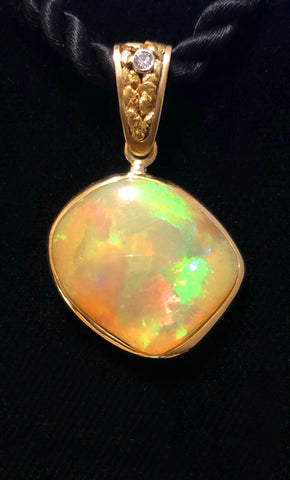Opal and 0.04ct Diamond Pendant