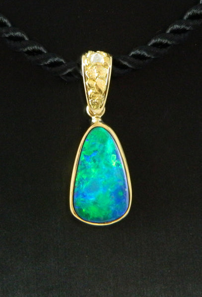 Opal and Diamond Pendant in 18kt Gold