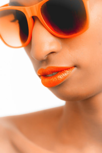 Who says brown or dark beauties can't carry off bright lipsticks!