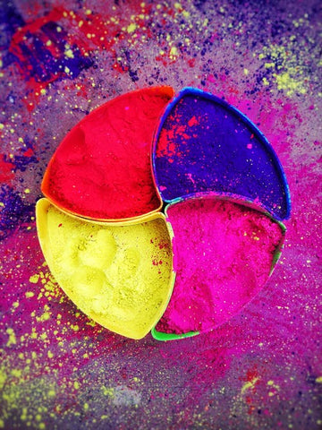 A plate with 4 sets of different holi colours