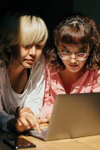 Two woman looking at a Laptop