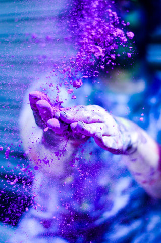 A person with full of colour during Holi