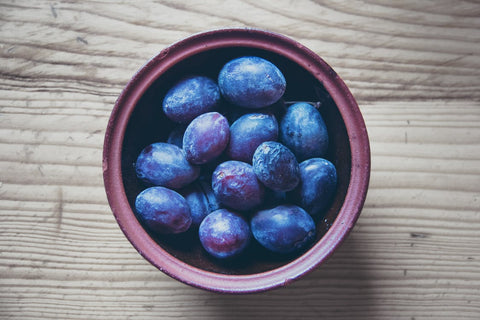 A bowl of purple Java Plums