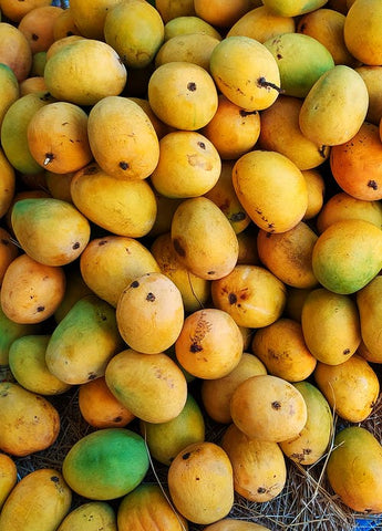 A bunch of juicy, ripe, yellow mangoes
