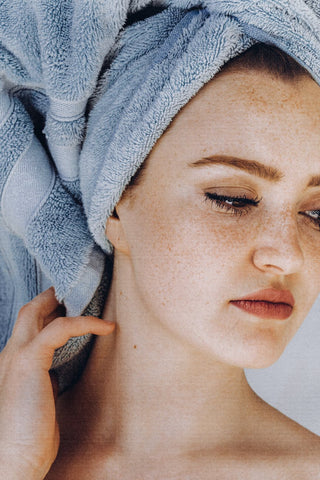 Woman with her hair wrapped in towel