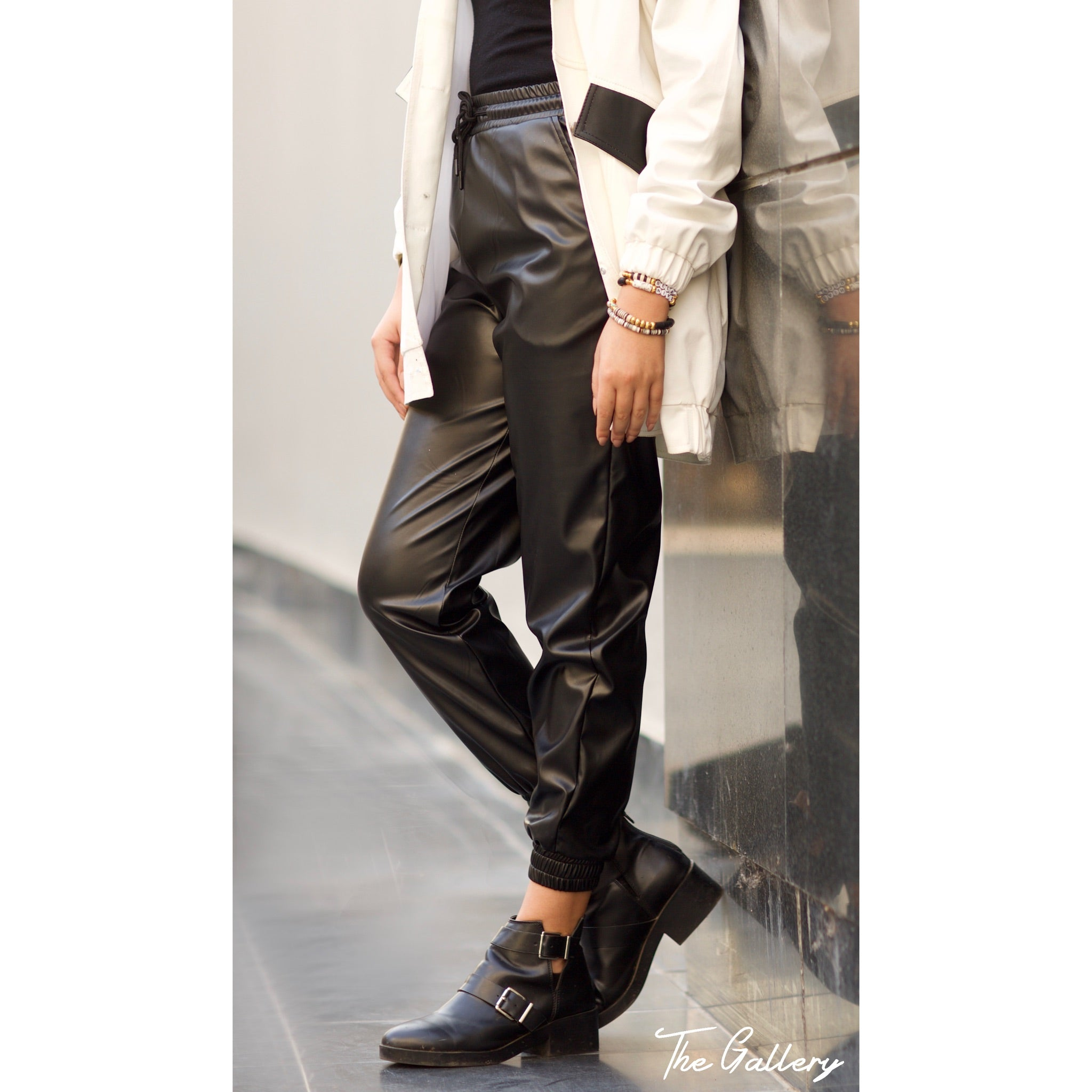 Black leather jogging pants