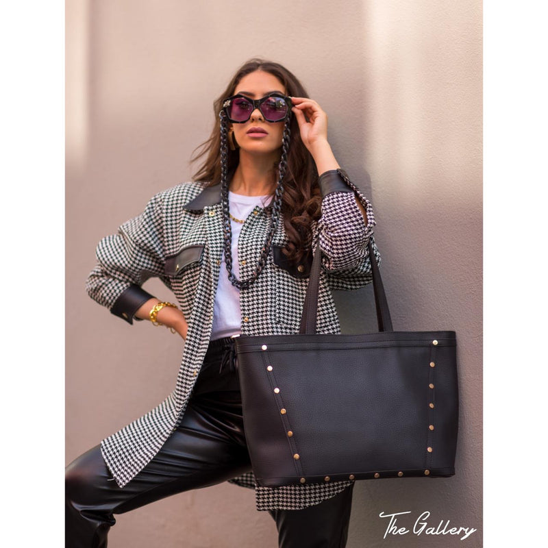 Studded black leather tote bag