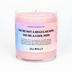 pink candle with you're not a regular mom, you're a cool mom text