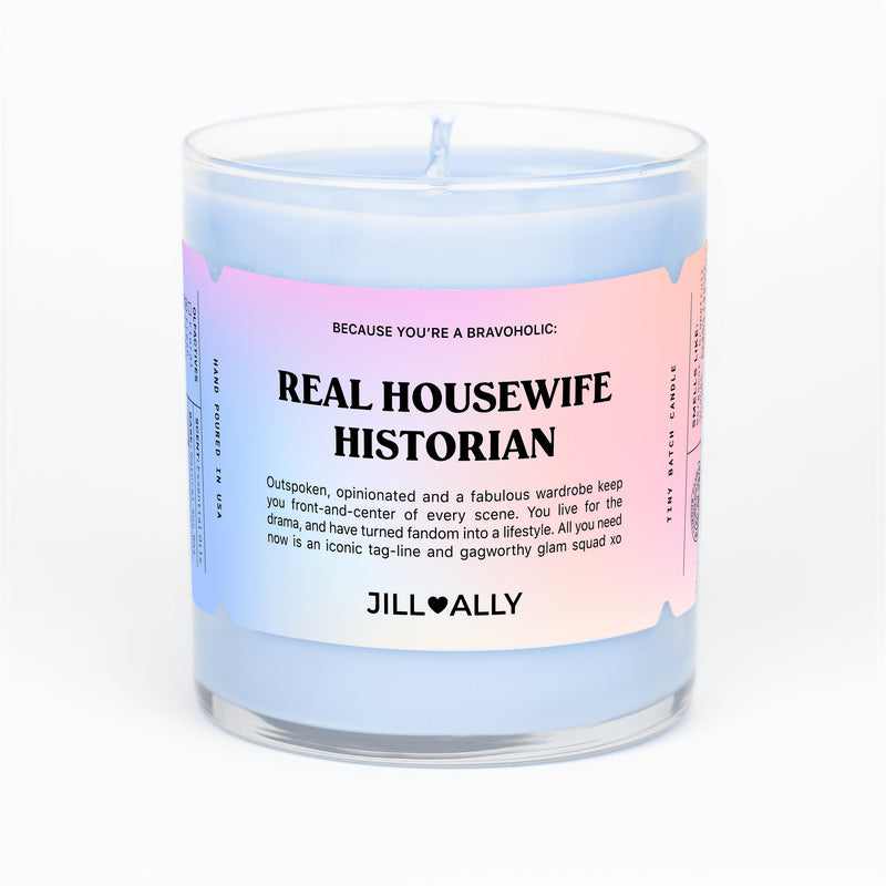 blue candle with real housewife historian printed on label