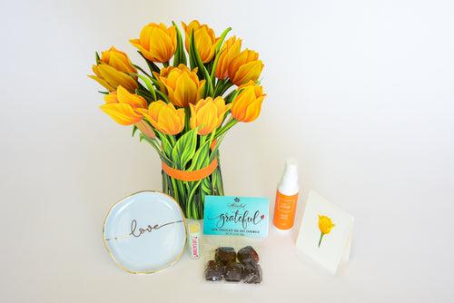 Marilyn's Gift has the perfect box to show your Mom how much you care.  This box includes: a fresh cut tulip flowers, a love trinket tray, Basic Jane Awake spray, a lip balm and Grateful dark chocolate sea salt caramels