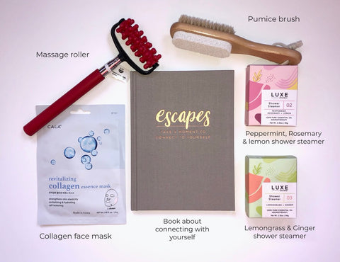 Our Pampering Box helps you relax and unwind.  The Pampering Box includes: a massage roller, a pumice brush, 2 shower steamers, a collagen face mask and a book called Escapes.