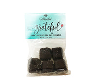 Load image into Gallery viewer, The Blossom Box includes Grateful Chocolates made by Abdallah. These dark chocolate sea salt caramels are sure to brighten your day.