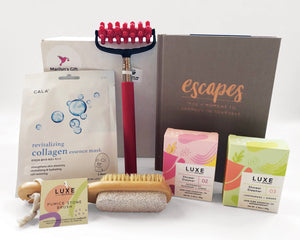 Our Pampering Box ships in September.  It is the  perfect way to spoil someone you love.  The box includes: a collagen face mask, massage roller, pumice brush, shower steamers and a book called Escapes.  There is also an extra sweet treat from Friday Harbor Chocolates.