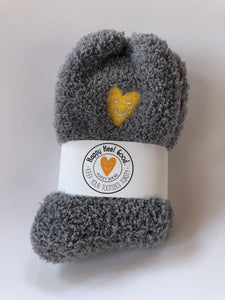 Warm comfy socks with a heart on them.  Perfect for curling up in front of the tv.