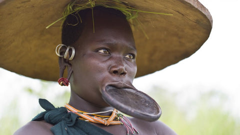 African Woman Lip Ring Collagen Stretching