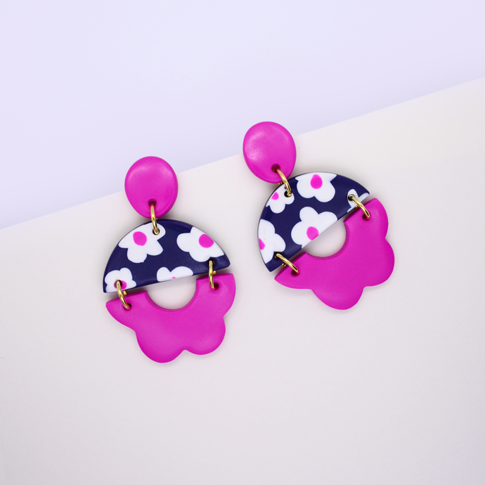 Summer floral statement drop dangle earrings with daisy motif and flower shape pattern in vibrant pink purple fuchsia color.