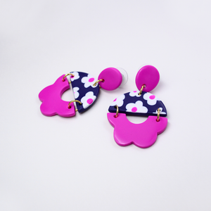 Polymer clay drop dangle earrings with daisy floral motif and flower shape pattern in pink purple fuchsia color.