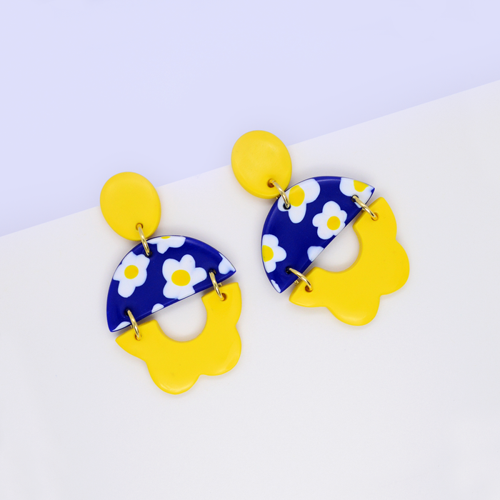 Summer floral statement dangle earrings with daisy flower motif pattern in bright yellow and blue color