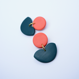 Polymer clay floral drop dangle earrings in orange coral and dark green teal color. Minimalist and basic flower shape earrings for everyday wear.