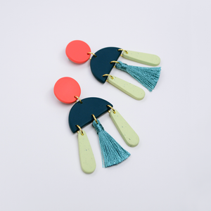 Polymer clay simple minimal everyday tassel drop dangle earrings in coral orange and teal turquoise dark green color. Luxe, modern and sleek boho inspired tassel earrings.