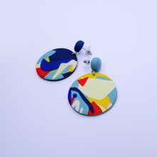 Load image into Gallery viewer, Big round drop and dangle statement earrings with pop art graphics. Modern, fashionable, and funky wearable art made of polymer clay.
