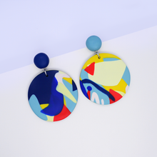 Load image into Gallery viewer, Polymer clay big round drop dangle earrings with pop art graphic motifs. Colorful and playful wearable art.
