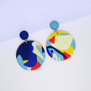 Polymer clay big round drop dangle earrings with pop art graphic motifs. Colorful and playful wearable art.
