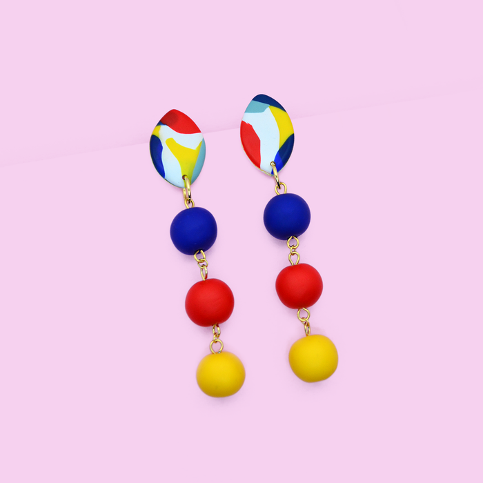 Polymer clay long drop dangle statement earrings with primary colors beads and pop art graphic. Modern and trendy wearable art.
