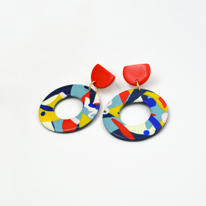 Polymer clay large hoop drop earrings with graphic pop art hoops and red studs. Colorful, playful, dynamic, cool and trendy earrings.