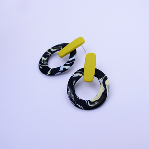Hoop bar stud earrings with asymmetric marble pattern in black and yellow color. High quality, handmade, one of a kind earrings.