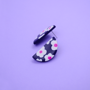 Polymer clay half moon shape studs earring with daisy motif floral pattern in navy and pink purple fuchsia color. Easy to wear everyday and super lightweight.