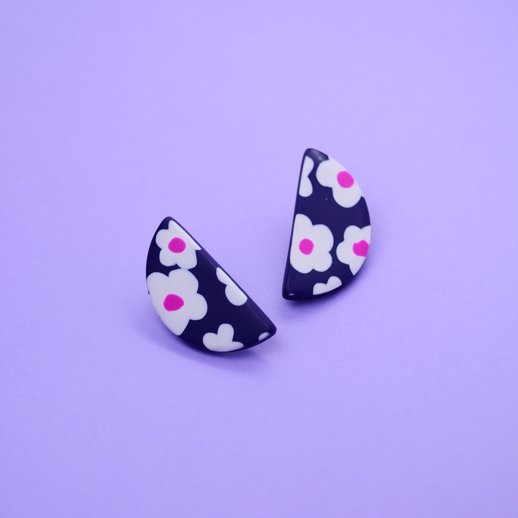 Polymer clay half moon shape stud earrings with daisy motif floral pattern in navy and pink purple fuchsia color. Easy to wear everyday and super lightweight.