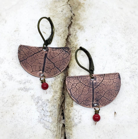 Copper lead impression earrings with red bead by Andie Kriedel