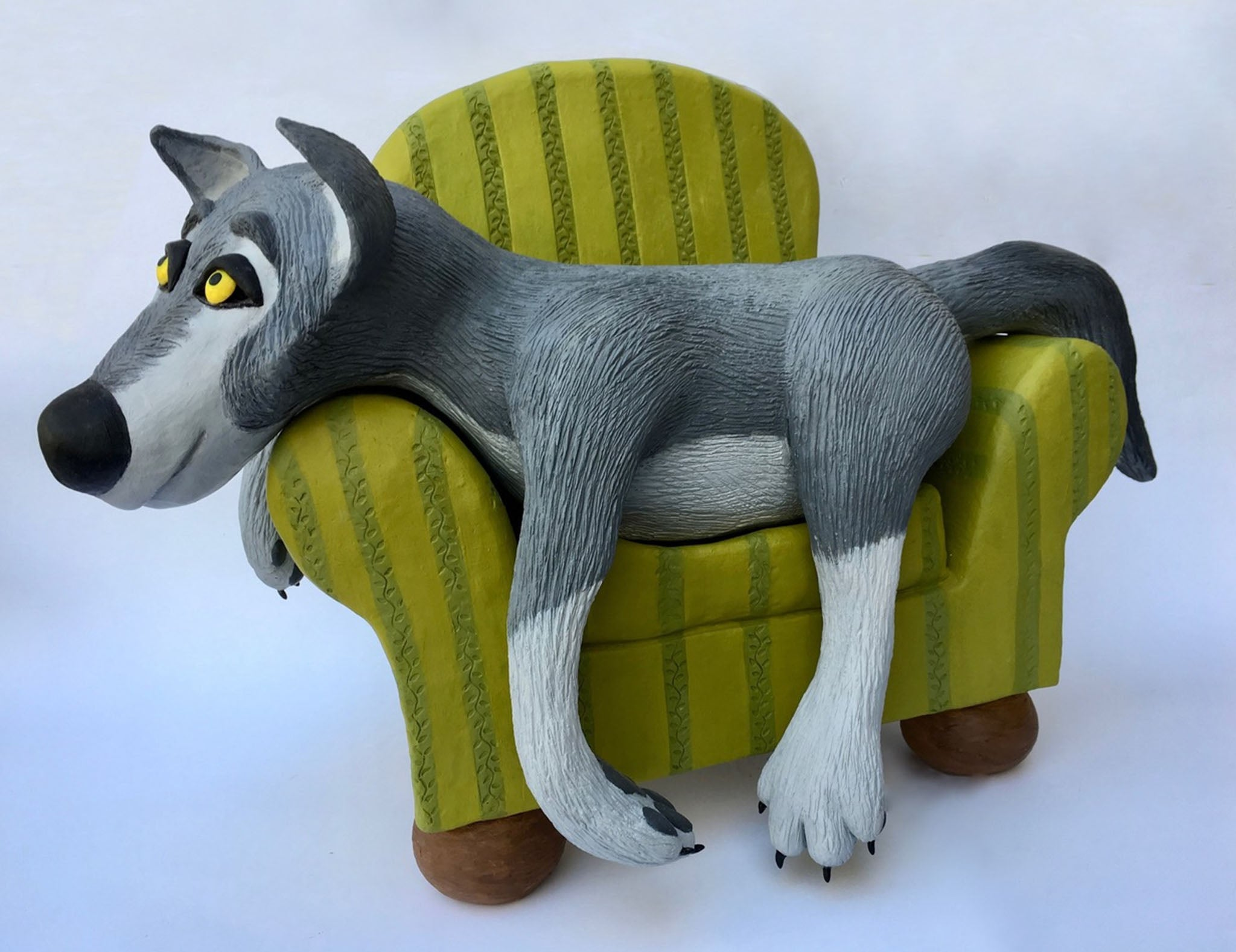 Wolf Relaxing - ceramic by Judith Marie