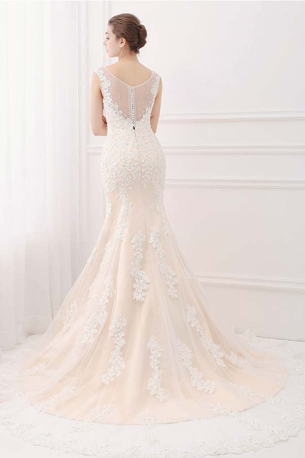 sheer back ivory lace champagne wedding gown