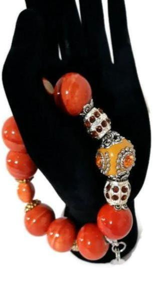Orange ceramic beads stretch bracelet, handmade bracelet, Elaini Arthur bracelet collection, The orange bracelet