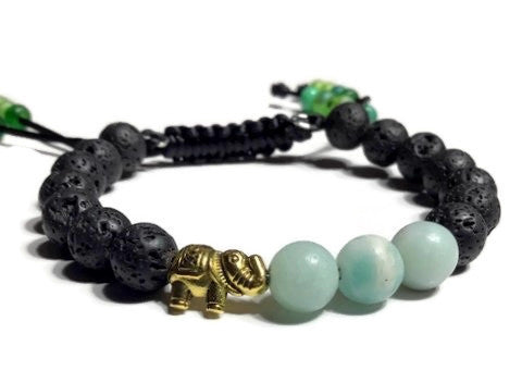 THE GOLDEN ELEPHANT DIFFUSER BRACELET, black lava rocks with green amazonite stones, macramê clasp, memory wire, woman's size, essential oil diffuser,