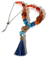 Blue leather tassel, statement beaded necklace, handmade necklace, boho chic style, The orange peacock necklace.
