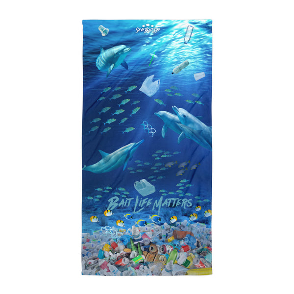 Dolphins on a beach towel admist plastic pollution and meant to create awareness, by Sushila Oliphant.