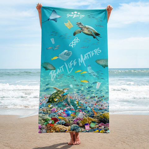 Sea turtles on a beach towel admist plastic pollution and meant to create awareness, by Sushila Oliphant.