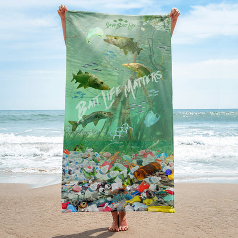 Sea turtles on a beach towel admist plastic pollution and meant to create awareness, by Sushila Oliphant at Save Bait Life..