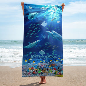 Dolphins on a beach towel admist plastic pollution and meant to create awareness, by Sushila Oliphant at Save Bait Life.