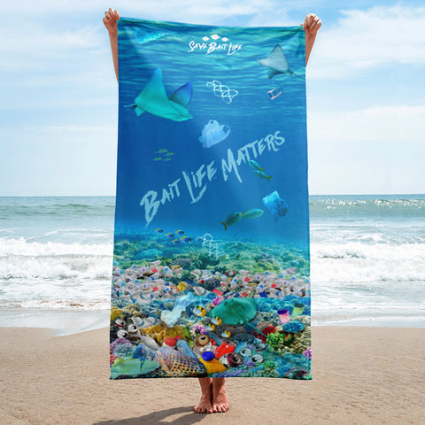 Stingrays on a beach towel admist plastic pollution and meant to create awareness, by Sushila Oliphant at Save Bait Life.