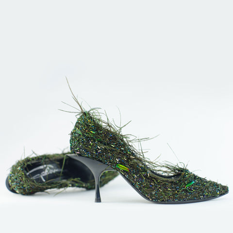 A token of love a feathered nest, a couture shoe with intricate hand stitched feather and beaded upper by Georgina Goodman