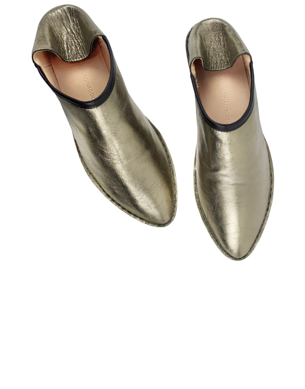 Gold leather slip on slipper shoes by designer Georgina Goodman. Shoes with cleaver features such as a hidden wedge and padded insole giving you all day comfort.