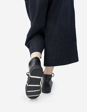 New sneaker by designer Georgina Goodman has a striped sole made from recycled otherwise waste product