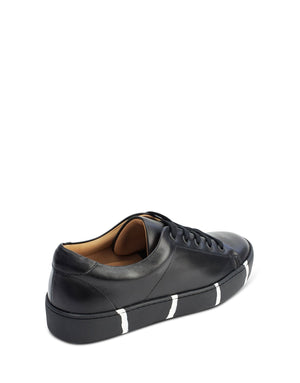 Minimal classic black leather low top trainer by designer Georgina Goodman