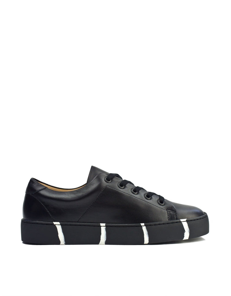 Minimal wardrobe essential sneaker with recycled sole by designer Georgina Goodman