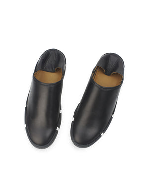 Black leather slip on sneaker with recycled striped sole by designer Georgina Goodman