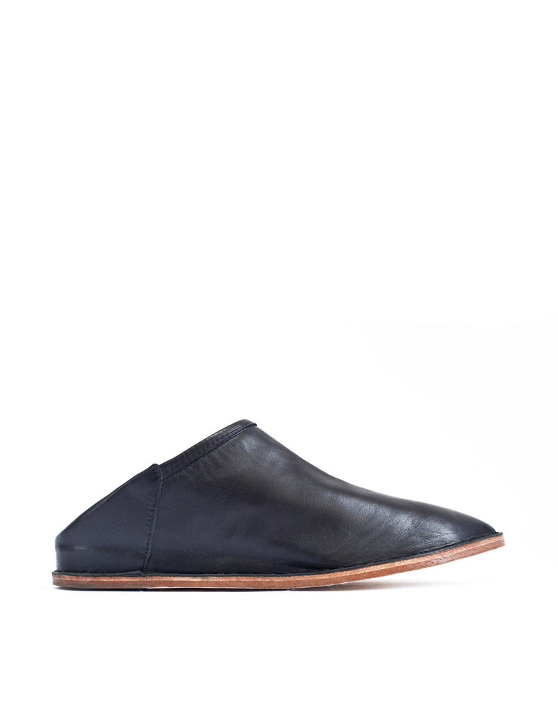 Classic minimal black leather slip on leather slipper shoe by designer Georgina Goodman, effortless style at any age